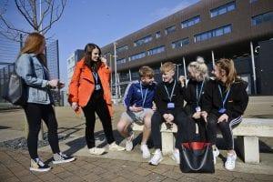 Channelside students talking outside