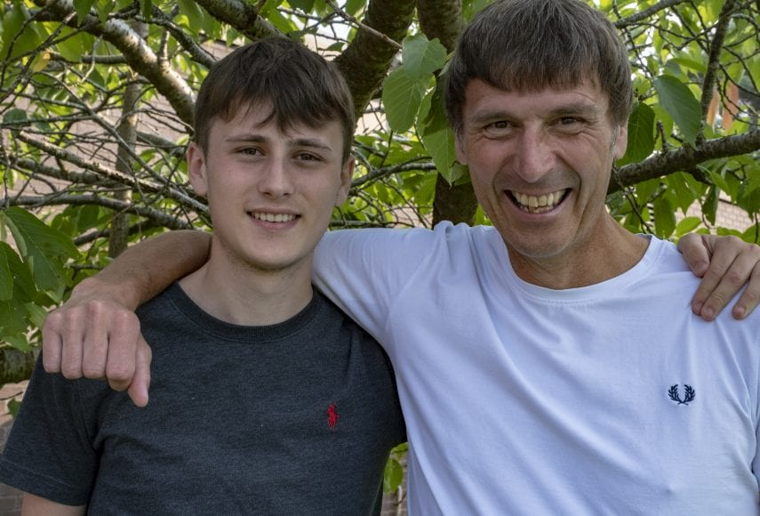 Sixth former Owen Wilson celebrates his excellent A Level grades with his dad Scott