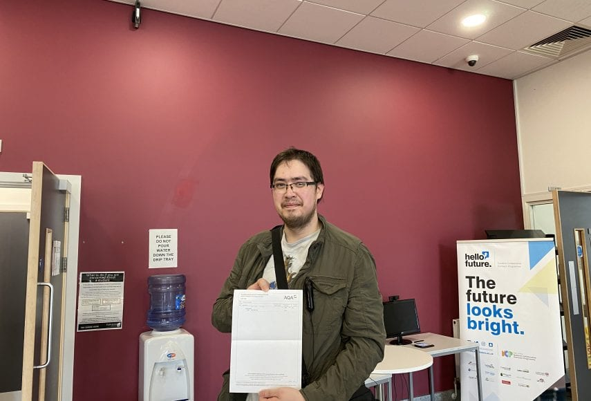 Student Jody Wall celebrates success in his GCSE results